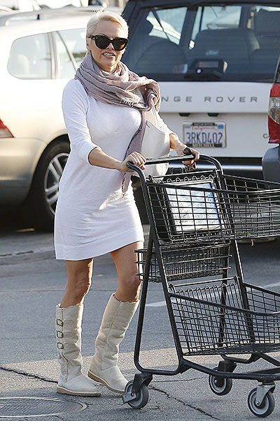 Pamela Anderson drops a few coins for salvation on her way out of the grocery store in Malibu